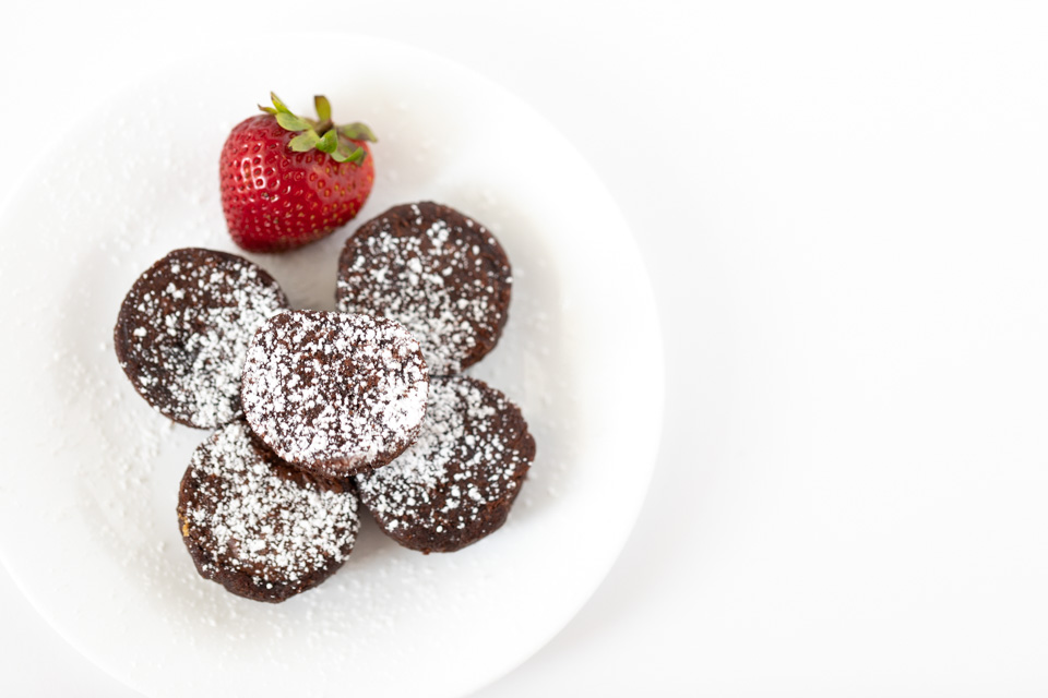 Brownie Bites with Powdered Sugar and a Fresh Strawberry
