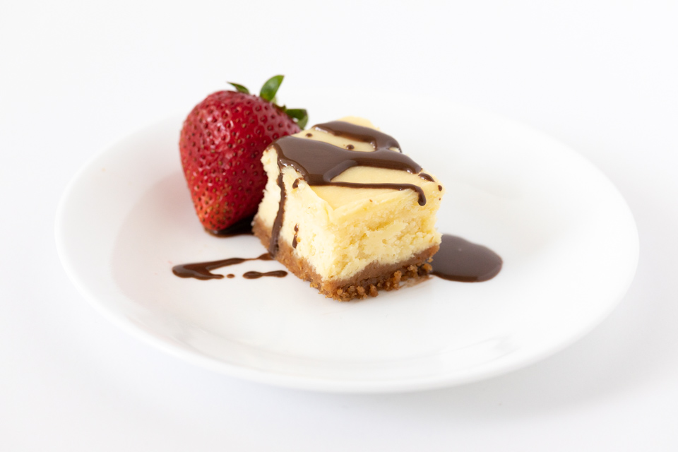Cheesecake Bite with Fresh Strawberry and Chocolate Sauce